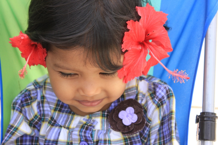 Asha wearing flowers in hair in hawaii