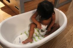 Asha eating in tub in Lisbon