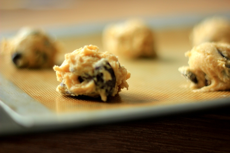 chocolate chip cookie dough on baking tray