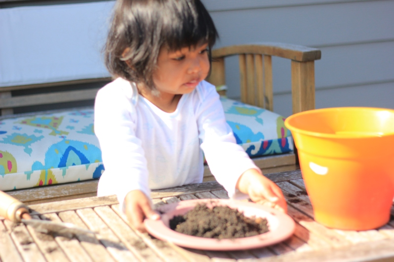 Asha Gardening and playing with dirt