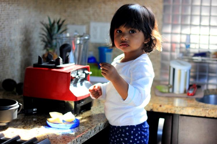 Asha making smoothie in Vitamix