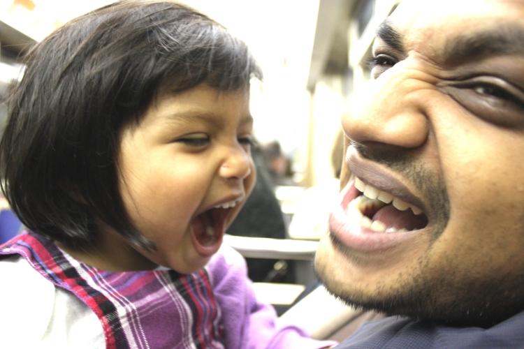 Asha eating Dad