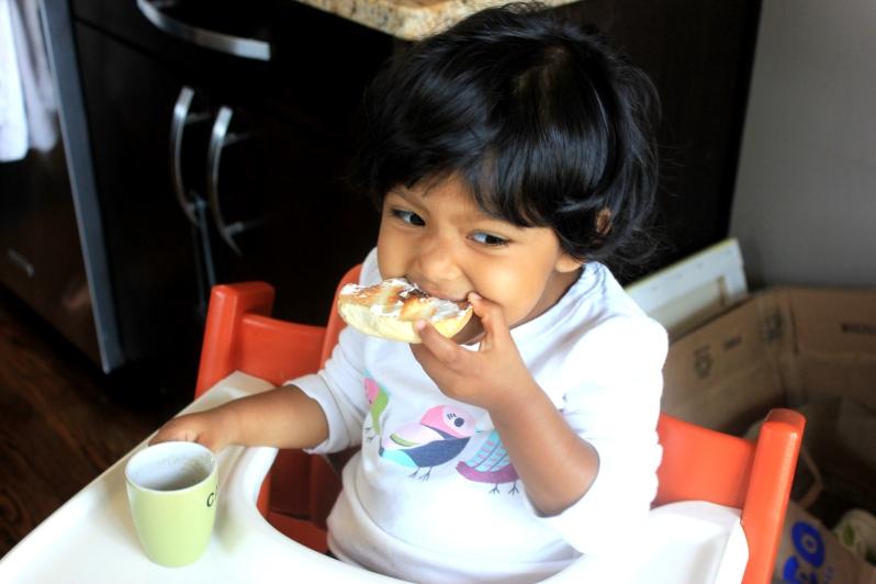 "Asha eating bagel and ""coffee"""
