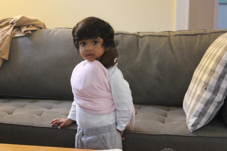 Asha wearing Monkey in a sling