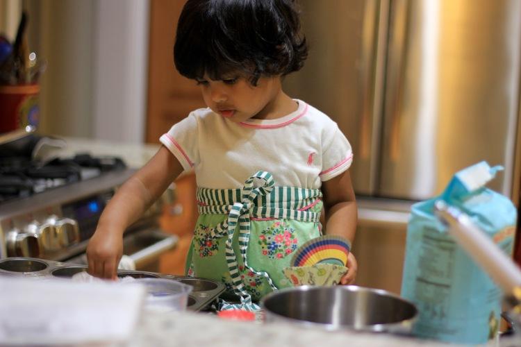 Asha baking cupcakes