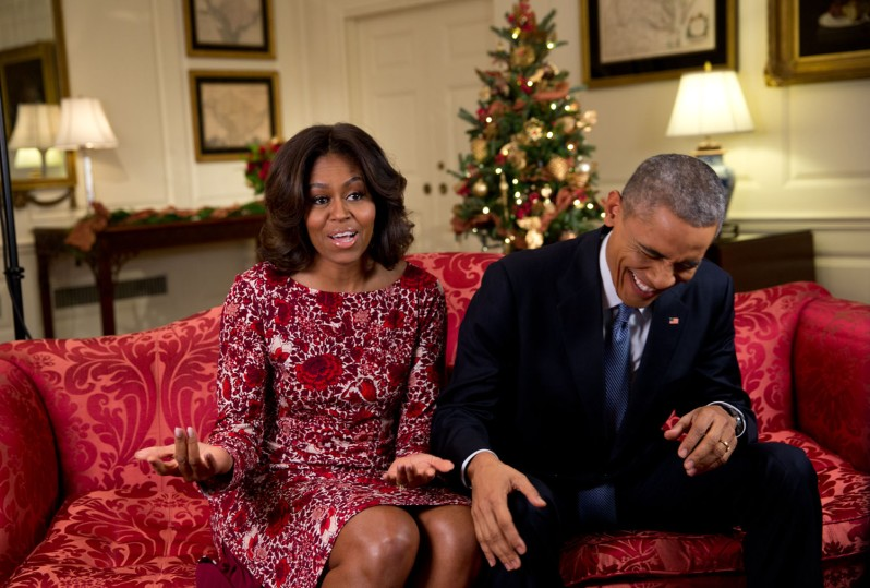 """Nov. 19, 2014 """"Lawrence Jackson captured the President busting out in laughter as he and the First Lady recorded a holiday video message in the Map Room of the White House."""" (Official White House Photo by Lawrence Jackson) This official White House photograph is being made available only for publication by news organizations and/or for personal use printing by the subject(s) of the photograph. The photograph may not be manipulated in any way and may not be used in commercial or political materials, advertisements, emails, products, promotions that in any way suggests approval or endorsement of the President, the First Family, or the White House."""