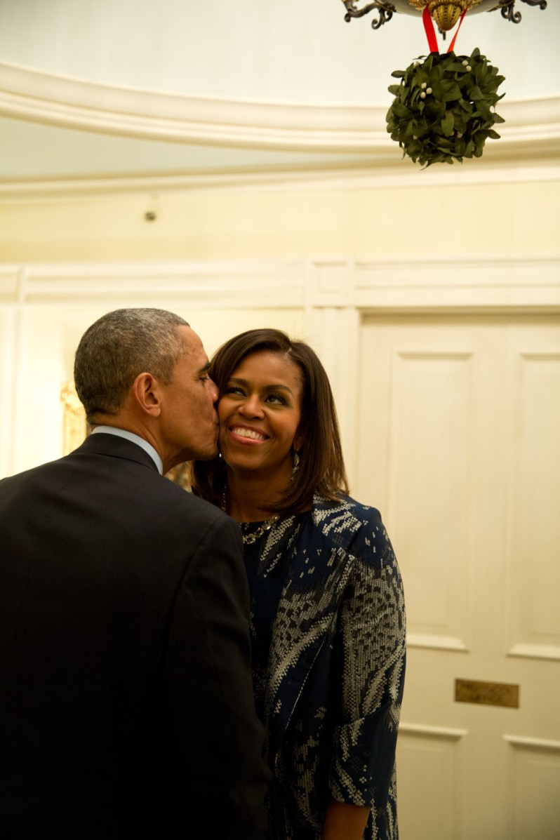 """Dec. 3, 2014 """"The First Lady and I both spotted the President standing under the mistletoe and she moved in to grab a kiss from him following a dinner for Combatant Commanders and military leadership at Blair House in Washington, D.C."""" (Official White House Photo by Pete Souza) This official White House photograph is being made available only for publication by news organizations and/or for personal use printing by the subject(s) of the photograph. The photograph may not be manipulated in any way and may not be used in commercial or political materials, advertisements, emails, products, promotions that in any way suggests approval or endorsement of the President, the First Family, or the White House."""