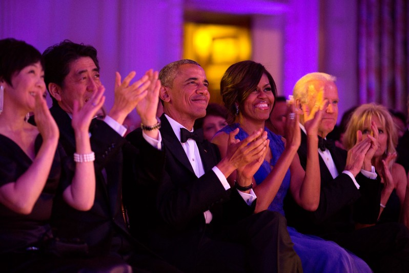 """President Barack Obama and First Lady Michelle Obama, with Prime Minister Shinzo Abe of Japan, First Lady Akie Abe, Vice President Joe Biden and Dr. Jill Biden, applaud the cast of """"Jersey Boys"""" during the State Dinner performance in the State Dining Room of the White House, April 28, 2015. (Official White House Photo by Pete Souza) This official White House photograph is being made available only for publication by news organizations and/or for personal use printing by the subject(s) of the photograph. The photograph may not be manipulated in any way and may not be used in commercial or political materials, advertisements, emails, products, promotions that in any way suggests approval or endorsement of the President, the First Family, or the White House."""