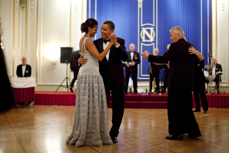 President Barack Obama and First Lady Michelle Obama dance during the 2009 Nobel Banquet in the Hall of Mirrors at the Grand Hotel in Oslo, Norway, Dec. 10, 2009. (Official White House Photo by Pete Souza) This official White House photograph is being made available only for publication by news organizations and/or for personal use printing by the subject(s) of the photograph. The photograph may not be manipulated in any way and may not be used in commercial or political materials, advertisements, emails, products, promotions that in any way suggests approval or endorsement of the President, the First Family, or the White House.