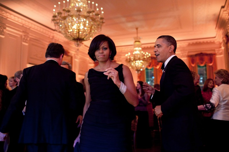 """Feb. 21, 2010 """"The President and First Lady were dancing along to the music of the Harry Connick, Jr., Big Band at the Governors Ball. Mrs. Obama turned towards me and, for one split second, looked right at me. Usually I strive to capture moments when the subjects are unaware of the camera. But this an exception where I actually liked that she was looking at me."""" (Official White House Photo by Pete Souza) This official White House photograph is being made available only for publication by news organizations and/or for personal use printing by the subject(s) of the photograph. The photograph may not be manipulated in any way and may not be used in commercial or political materials, advertisements, emails, products, promotions that in any way suggests approval or endorsement of the President, the First Family, or the White House."""