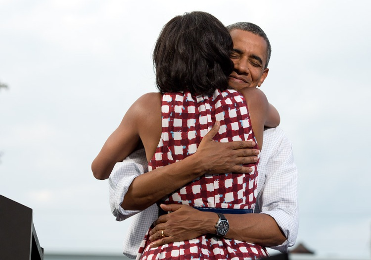 "Aug. 15, 2012 ""The President hugs the First Lady after she had introduced him at a campaign event in Davenport, Iowa. The campaign tweeted a similar photo from the campaign photographer on election night and a lot of people thought it was taken on election day."" (Official White House Photo by Pete Souza) This official White House photograph is being made available only for publication by news organizations and/or for personal use printing by the subject(s) of the photograph. The photograph may not be manipulated in any way and may not be used in commercial or political materials, advertisements, emails, products, promotions that in any way suggests approval or endorsement of the President, the First Family, or the White House."