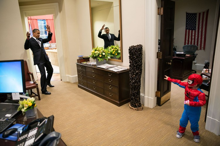 """Oct. 26, 2012""""The President to be caught in Spider-Man's web as he greets the Nicholas Tamarin, 3, just outside the Oval Office. Spider-Man had been trick-or-treating for an early Halloween with his father, White House aide Nate Tamarin in the Eisenhower Executive Office Building. I can never commit to calling any picture my favorite, but the President told me that this was HIS favorite picture of the year when he saw it hanging in the West Wing a couple of weeks later.""""(Official White House Photo by Pete Souza)This official White House photograph is being made available only for publication by news organizations and/or for personal use printing by the subject(s) of the photograph. The photograph may not be manipulated in any way and may not be used in commercial or political materials, advertisements, emails, products, promotions that in any way suggests approval or endorsement of the President, the First Family, or the White House."""